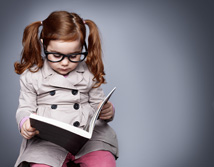 Little girl sitting down reading a book - Bank Financial Resources